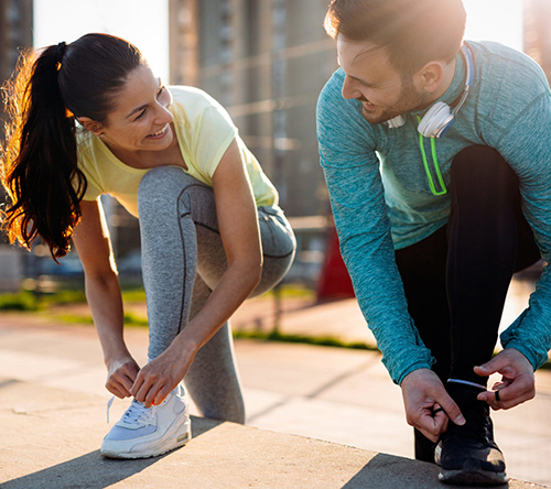 two active people getting ready for a run
